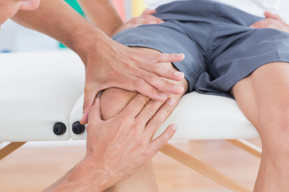 Doctor evaluates someone for knee pain